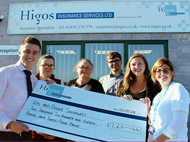 HIGOS Presenting a Cheque to Ups and Downs Southwest