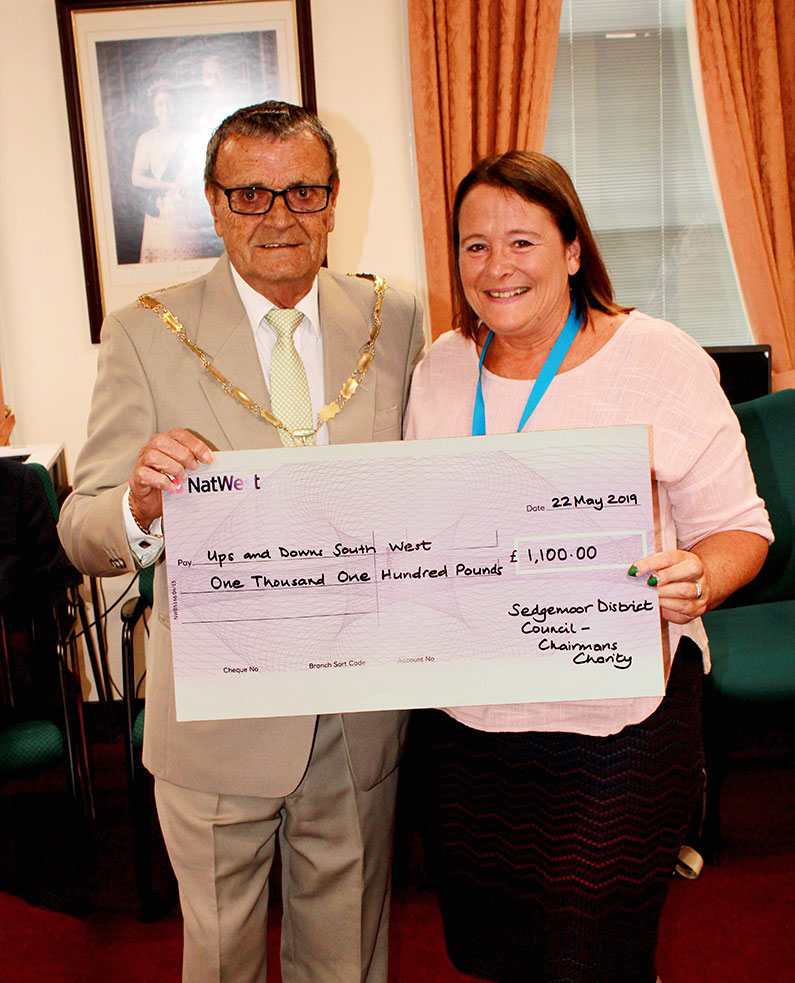 Sedgemoor District Council Charity of the Year Mike Cresswell presenting Jo Thorn with a cheque.