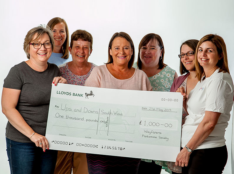 Wayfarers Pantomime Society present cheque to Ups and Downs Southwest